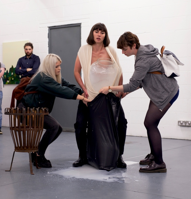 The sacrificed calf feeds from the swollen udder, audience members; Jill Abbot and Ciara O' Brien, photo. Marcus Cassidy